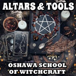 Witchcraft altar with tools, tarot cards, candlees, herbs sppon and book of shaddows